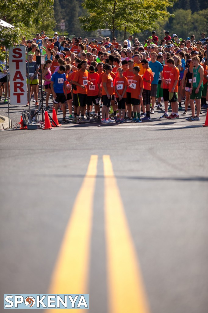 vertical photo of runners gathered at the start of the race